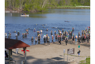 Swimming before the start is one triathlon warmup strategy.